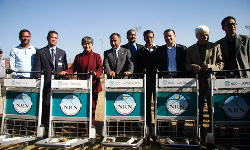 The Non-Resident Nepali Association President Dr. Upendra Mahato handed over trolleys for the airport at Kathmandu