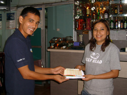 Mrs. Puja Shrestha presenting the Air ticket to Lucky winner Mr. Dipendra Rajbhandari